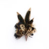 Melanistic Pheasant Feather Hat Pin Brooch Lapel Pin in a copper cone on a white background.