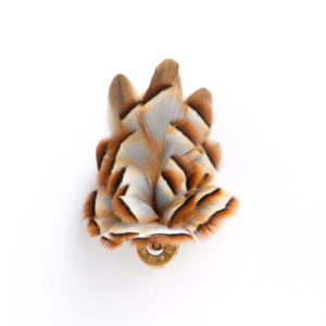 All Partridge Feather Hat Pin / Lapel Pin / Brooch in a 12 bore cartridge base on a white background.